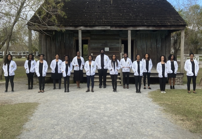 Black Med Students Pose In White Coats In Front of Former Slave Plantation